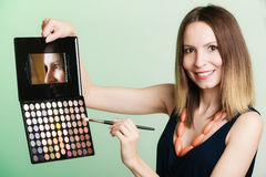 Woman holds makeup professional palette and brush Royalty Free Stock Photography