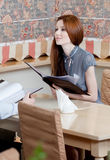 Woman holds the menu to make an order Royalty Free Stock Photo