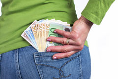 Woman holds the money in her pocket Royalty Free Stock Photo