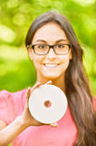 Woman holds multimedia disk Stock Photography