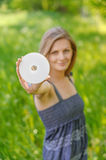 Woman holds multimedia disk Royalty Free Stock Photos