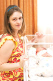 Woman holds new-born in a hospital chamber Royalty Free Stock Photos