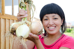 Woman holds onion Royalty Free Stock Photos