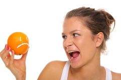 Woman holds orange with insult Stock Photos