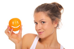 Woman Holds Orange With Smile Royalty Free Stock Photos