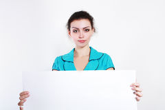 Woman holds out a big blank card Royalty Free Stock Photo