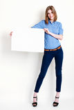 Woman holds out a big blank card Royalty Free Stock Images