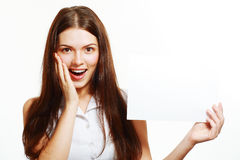 Woman holds out big card Royalty Free Stock Photo