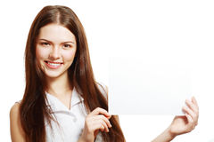 Woman holds out big card Royalty Free Stock Images