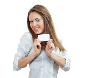 Woman holds out a business card Stock Photos