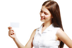 Woman holds out a card Royalty Free Stock Photography