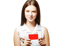 Woman holds out a card Royalty Free Stock Photos