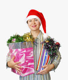 The woman holds packets of New Year's ornaments. On white background Royalty Free Stock Image