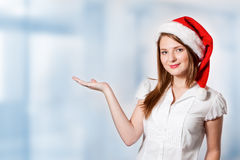 Woman holds palm for blank ad space Royalty Free Stock Image