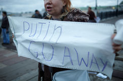 Woman holds a placard Putin Go Away. Stock Photography