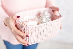Woman holds a plastic organizer with different objects Stock Image