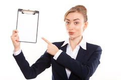 Business woman shows on your ad royalty free stock images