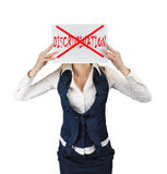 Woman holds a poster with the word crossed out discrimination Royalty Free Stock Photography