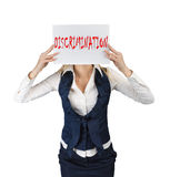 Woman holds a poster with the word discrimination Royalty Free Stock Photo