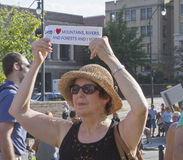 Woman Holds Pro Environmental Sign at Moral Monday Rally in Ashe Royalty Free Stock Images