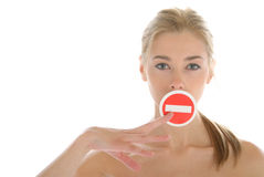 Woman holds prohibiting sign before mouth Royalty Free Stock Photos