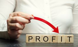 A woman holds a red down arrow above the word Profit. Unsuccessful business and poverty. Profit decline. Loss of investment. Low. Wages. Economic crisis. The stock images