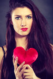Woman holds red heart love symbol Stock Photos