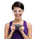 Woman holds retro photographic camera Royalty Free Stock Photos