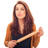 Woman holds rolling-pin Royalty Free Stock Photo