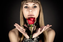 Woman holds a rose Stock Photo