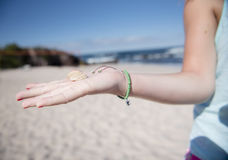 Woman Holds a Sea Shell in Her Hand in Mexico Stock Images
