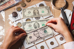 Woman holds a set of dollars in the pockets Royalty Free Stock Photography