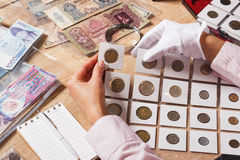 Woman holds a set of old coins Royalty Free Stock Photography