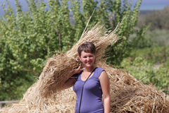 Woman holds sheaf of wheat Stock Photo