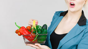 Woman holds shopping basket with vegetables Royalty Free Stock Photography