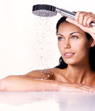 Woman holds shower in hands  with falling water Stock Photos