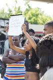 Woman Holds Sign in Ferguson Demonstrations Royalty Free Stock Photography