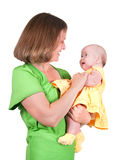The woman holds the small child Stock Photos