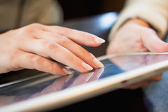 Woman holds a smartphone telephone, works on the digital tablet, soft focus Royalty Free Stock Image