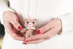 Woman holds soft toy bear Royalty Free Stock Photos