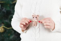 Woman holds soft toy bear Royalty Free Stock Photography