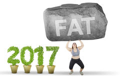 Woman holds stone with fat word Royalty Free Stock Photography