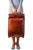 Woman holds suitcase Royalty Free Stock Photography