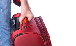 Woman holds suitcase in hands. Stock Image