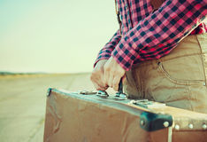 Woman holds suitcase Royalty Free Stock Images