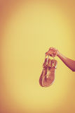 Woman holds summer shoes pair of sandals Royalty Free Stock Image