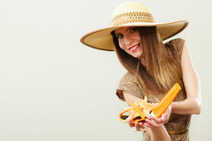Woman holds sunglasses and sunscreen lotion Stock Photos