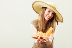 Woman holds sunglasses and sunscreen lotion Royalty Free Stock Photos