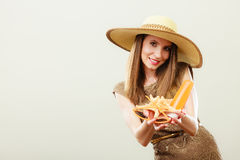 Woman holds sunglasses and sunscreen lotion Royalty Free Stock Photo
