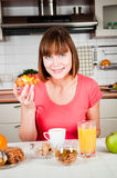 Woman holds sweet bun with fruits Royalty Free Stock Image